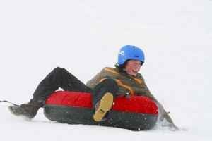 C Lazy U Ranch :: All-Inclusive guest ranch with gourmet meals, luxury lodging, Snow tubing, & luge sledding! Nothing is more family-friendly than sliding down a snow-covered hill!