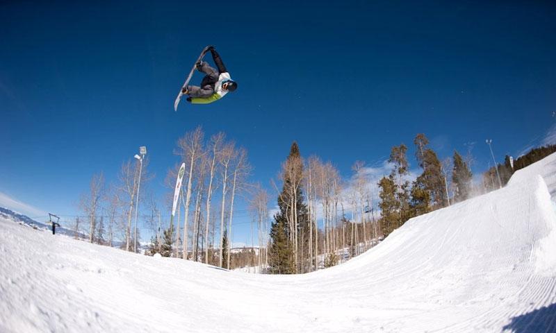 Snowboarding at SolVista Terrain Park